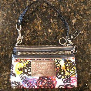 Used multi color Coach purse